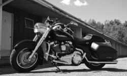 Road King Custom - 103 cu in. conversion ( 5,000 k on conversion), vance and hines ovals, lots of extra chrome, quick release tour pack, heated corbin rumble seat, after market handle bars and mirrors, quick release fairing with cd player, origional seat