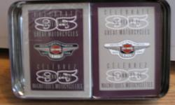 1998 Anniversary Edition Harley Davidson Playing Cards.  95th Edition  collector tin.  Raised Harley on the front of the tin.  2 decks of cards, neither used, however the cellephane was removed from one deck.  Numbered tin #248457 of 355000. Brand new