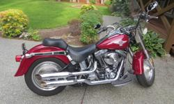 2006 Harley Fatboy, Low Kms, comes with detachable bags, windshield, screaming eagle pipes and original pipes, Harley Sundowner extra seat, excellent condition.
