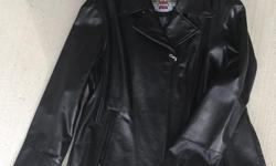 Gorgeous, genuine Harley Davidson Ladies XL leather jacket. Classic style. Has epaulets, zipped sleeves and sides. embroidered logo on sleeve. Studded logo on back. Never worn. No padding. Also have a man's leather jacket and chaps.