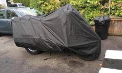 Harley Davidson motorcycle cover with antenna holes. Used for one season under carport Call David at 778-426-1266 for questions