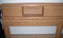 """Light/medium oak laminate. Sliding compartments with brass coloured trim. Measures 63.5"""" wide by 40"""" high. Delivery available for extra charge."""