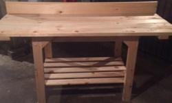 """Heavyduty work bench for sale.Will deliver Bench size is 72""""L x 28""""W x 34""""H. $85.00"""