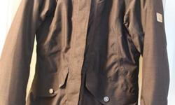 "Used Winter Jacket in excellent condition. no damages or holes waterproofed 30"" long dark Grey/ Black"