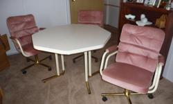 """4 piece dinette includes 42"""" hexagon table w/ arborite top and 3 mtaching swivel armchair on castor wheels ... $60.00"""