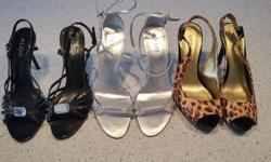 3 pairs of high heels. The black ones are barely used. The other two are brand new, never used. Make me an offer for a pair, two or the bundle. Sizes, brand and availability : Leopard (guess) : 7 1/2 moyen <- not sold Silver (guess) :7 1/2 moyen <- not