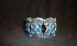 """North Shore"", flexible hinged wrap cuff bracelet.  Brand new.  Beautiful blue stones.  $30."
