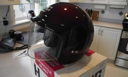 HJC IS THE MAKE, VERY COMFORTABLE TO WEAR. SIZE IS LARGE. DOT APPROVED COLOR IS BURGANDY OPEN FACE WITH ADJUSTABLE VISOR (3 SETTINGS) ORIGINAL BOX & COVER HAS NEVER BEEN ABUSED, IT IS IN EXCELLENT CONDITION CALL 250-756-9643 TO VIEW