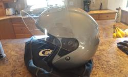 Barely used, no scratches and comes with helmet bag $50 for the helmet Also selling a pair of lightly used comfy thinsulate black leather gloves size M for $10