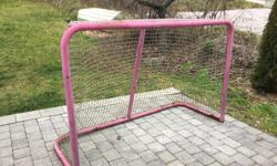 Well loved hockey net. Both metal and netting in good shape. Comes with a heavy plastic shooter tutor that attaches to the net with velcro strips.