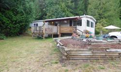 # Bath 1 Sq Ft 1104 MLS 414644 # Bed 3 Imagine living on your own private acreage with a seasonal creek, and waterfall... Look no further..Located short drive to downtown Nanaimo at the end of a quiet dead end road. This 3 bedroom manufactured home has