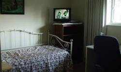 Large furnished bedroom in family home.  Available now    Quiet, close to buses and schools- Mundy & Austin Coquitlam area.  includes washer-dryer, Hot Tub, large sundeck, yard, Internet, Cable,  Non-smoking    Home cooked meals extra.  Our student of 7