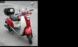 Excellent condition. 1295 km. Only ridden in the summer. Always garage stored. Comes with weather shield, cover and parcel box. New battery and recent oil change. Fun, zippy scooter, excellent on gas, $5 fill-up. $1800 OBO.