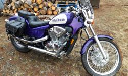heres a beautiful 1995 600 honda shadow for sale,has low kms 25 000kms,works perfect,has saddle bags,windsheild,nice aftermarket exhaust,not inspected,only thing it might need is a front tire,its border line passing $2200 firm sorry im not moving off