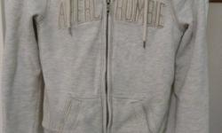 hoodie sweater thick & warm enough to be a jacket full zip up by Abercrombie & Fitch soft fuzzy inside cream- grey colour with off-white inside size Womens Small or Teen Girl 14-16 has pockets & hood string great condition - no rips, holes, stains sells
