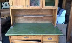 Great Antique Hoosier cabinet with metal drawer for flour. We are moving so great deal!