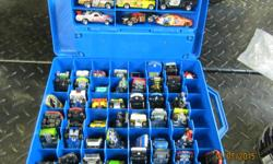 50 HOT WHEELS WIT CASES . ALSO MORE CARS AND TRUCKS . MARBLES . TRANSFORMERS ..... $25