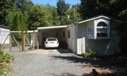 # Bath 2 Sq Ft 1339 # Bed 3 Lovely well maintained 1995 3 bedroom 2 bath Manufactured home on own lot in Mill Bay at the end of a cul-de-sac. There is a large bonus room with it's own bathroom to use as bedroom or rec room. Property is .5 acre with a park