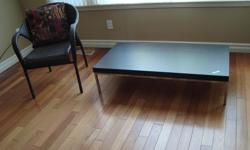 """IKEA coffee table in black/brown wood grain on chrome frame and like new condition. 11""""H, 23"""" D, 46 1/2"""" W"""