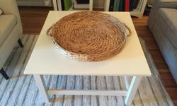 Painted white. The basket is from a store downtown Victoria. The basket included would be 130