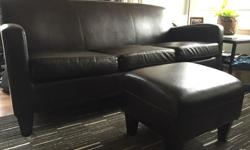 "IKEA jappling sofa and footstool. Great condition. Sofa is 72""."