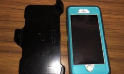Unlocked 32 gig iPhone 6 with Otter Box Ballistic case. Phone is in excellent condition, has never been used outside of the case. The blue you see is the case not the phone.