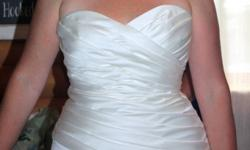 Simple ivory wedding dress that flatters any figure. Purchased at Moments in Truro, in August 2011. Sizes 12 to 16, can be altered easily. Drycleaned and ready to go. Near Truro. Please e-mail or call 662-3800  leave message. Ask for Tanya.