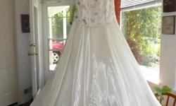 Beautiful Dalia ivory wedding gown. Fitted corset bodice with delicate gold embroidery and iridescent sequins. Full length silk taffeta skirt with organza overlay. Matching organza wrap included. Size Small $175. You are welcome to come try it on, or take