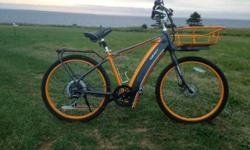 Orange/Grey Color. Bike specifications available on-line. Can be used by male or average height female.