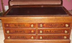 Oak J.P. Coates thread cabinet, great shape with emblem on back.  Six drawers with liftup top and brass knobs.  Great coffee table and good conversation piece.  Asking $900.00 firm call (250) 756-0733 leave message.