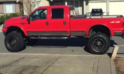 """Make Ford Trans Automatic Runs great has v10 gas with headers and auto Trans low kms full tow package . 44 inch tires and a 12 inch lift , great stereo and sub with 3 tv""""s . To much to list a must see open to real offers no time wasters"""