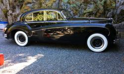 Make Jaguar Year 1960 1960 JAGUAR MK9 luxury saloon.The car is presently in dry storage & on blocks. Pictures show rear fender skirts removed for new tire mounting.PRICE FIRM enquire if interested.
