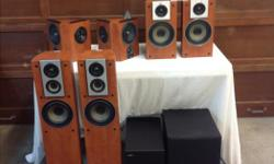 """Jamo 7.2 home theatre speaker system. Jamo 7.2 channel home theatre speaker system. All speakers in excellent condition and cared for. Speakers are finished in 'applewood'. Front towers, bookshelves, center, and bipolar surrounds. Also included is a 8"""""""