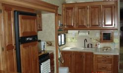 3 Slides,fireplace,10 cu ft fridge, 12 gal.hot water tank, micro.42 in flat screen tv, dvd ,surround, 50 amp service, on suit washroom. 90% of warranty work done by Jayco factory well maintained unit never seen snow,owned by seniors, must sell for health