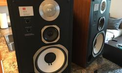 Here for sale is an excellent set of classic JBL's. The foam surrounds have been prefessionally replaced using the proper materials. The cabinets have been refinished beautifully and this set really presents well. Included are the grills which are as well