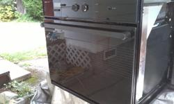 """Fits and opening 30"""" wide x 28"""" high. Can be seen powered-up and working. Self-cleaning, clean, attractive unit. 240 volt. $ 250 if picked-up, or can drop-off anywhere in Nanaimo, for a total of $ 270. PHONE-CALLS ONLY please at 250-327-3939. Will remove"""