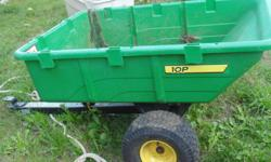 For John Deer Lawn Tractor - trailer/cart has dump feature for quick release. Can carry up to 10 cu. ft or 650 lbs. Cost $249.00 new at Home Depot