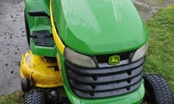 John Deere X300 Garden Tractor. 2006 model. Low hours (195.8). 42 inch cutting and mulching deck eliminates need for bagger. Always stored indoors. Excellent condition. $2300.