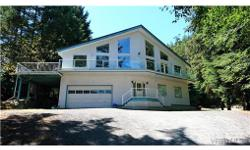# Bath 3 Sq Ft 2714 # Bed 3 Naturally Bright & Spacious Custom West Coast Home ideally perched high on a quiet & private .52 acre lot boasts an untouched west coast outlook with water glimpses. Just minutes from the beach, & located on the edge of East