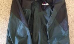 Kamik Waterproof Rain Jacket Mens Size Medium 3/4 length style. 65% PVC 35% Nylon Nylon lining with breathable mesh Drawstring bottom. Jacket has roll away concealable attached hood with cord locks on drawstrings Full Zipper front closure, storm flap and