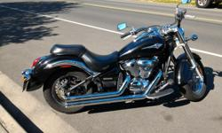 Black Kawasaki Vulcan 900 Classic great condition low kms. Beautiful bike. Great sound with custom muffers. The bike comes with a bike cover, 2 helmets, 2 pairs of gloves, heated vest, pants and leather jacket. I also have original pipes for bike. The