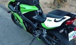 Great bike runs well new painted helmet really nice tank bag. Ready for the road. Please call or text Trevor at 250-896-4244.