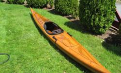 Beautiful handcrafted cedar kayak. Unique three dolfin design. Excellent condition. Includes cover, stands, paddle, paddle float, throw rope, neoprene skirt and deck compass.