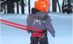 "RC's ""Ultimate Kids Ski Training Harness"" features a safety handle designed to help adults safely lift children onto chairlift and a 16 ft. leash to help them learn and link turns. The handle enables parents to load and unload children on the chairlift"