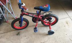 Spider man themed bike with training wheels. Great condition. Thomas the train themed helmet included