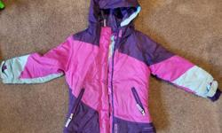 Girls winter jacket with hood. Size XS (4-5). Powder skirt around waist. Zippered pockets, a secret inside pocket, velcro wrist cuffs and built-in warm wrist liners with thumb hole. Sleeves show some wear, but otherwise in good condition. Kept our