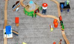 Used Good Condition, wooden train set. One motorized train that stops, moves forward and backwards. Additional train and track pieces included.