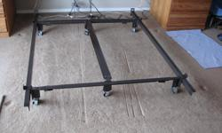 In excellent condition, heavy duty bed rails with center support . With two locking castors. Adjustable from king size(see castor dents in carpet) to double size box springs.