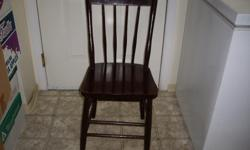 wood with spindles on the back, dark brown
