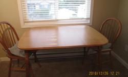 Kitchen table , 4 chairs, solid wood, plus 18 inch extra leaf, chairs have cushion